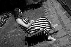 Slanted stripes (Franco & Lia) Tags: campania ravello street fotografiadistrada photographiederue noiretblanc biancoenero blackandwhite ragazza girl strisce stripes panchina bench diagonale diagonalcomposition banksy tattoo