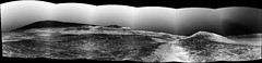 The Center of Gale Crater, variant (sjrankin) Tags: 13january2020 edited nasa mars msl curiosity galecrater panorama mountains mountsharp craterrim sky haze rocks sand dust grayscale processed