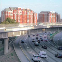 Atlanta / Interstate 75 / 85 (swampzoid) Tags: interstate highway 75 85 atlanta freeway catwalk overpass expressway city twin buildings traffic i85 i75 downtown connector below underneath beneath passing through bridge beyond two architecture red brick square crop cars