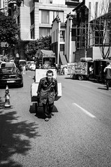 Cart pulling (Go-tea 郭天) Tags: chongqing républiquepopulairedechine pull hard boxes cart heavy pulling difficulty shadow portrait sun man muscles work walking alone walk duty working sunny business strong lonely difficult street city people urban blackandwhite bw white black outside blackwhite outdoor candid transportation delivery bnw delivering china light monochrome canon asian eos prime asia natural chinese naturallight 24mm 100d