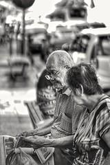Sharing. (J316) Tags: j316 elderly elders georgetown sony a7iii 85mm f14 samyang penang malaysia bw