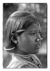 Odisha : Dharua girl - 3 (foto_morgana) Tags: adivasi adolescent analogphotography analogefotografie photographieanalogue asia asie azië asiangirl blackwhitephotography canoneos1 child dharua doubleportrait face gezicht visage fille filmnoir girl hairpin haarspeld head headshot india indigenousculture jewellery joaillerie sieraad kodakt400cn koraput lookingaway monochrome nikoncoolscan necklace collier halsketting nosejewel noseplug on1photoraw2020 portrait portret portraiture topazdenoiseai travelexperience vuescan zwartwitfotografie