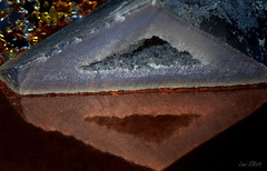 Triangle in a Triangle....Macro Mondays! (Lani Elliott) Tags: macro upclose photographymacro unlimited reflection reflections agate gemstone mineral crystals geode polyhedroid polyhedroidagate triangleinatriangle closeup light bright triangle macromondays