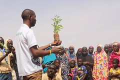 The executive secretary of JVE sensitizing the population on the benefits of trees