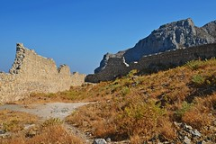 the castle walls :) (green_lover (your COMMENTS are welcome!)) Tags: wall castle ruins archangelos rhodes greece history mountain path cloudless