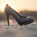 Thrown away high heel as symbol of short lifespan of fashion products