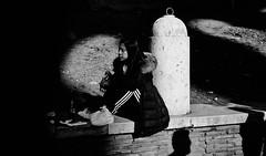 Light pooling. (Baz 120) Tags: candid candidstreet candidportrait city contrast street streetphoto streetcandid streetportrait strangers rome roma ricohgrii europe women monochrome monotone mono noiretblanc bw blackandwhite urban life portrait people provoke italy italia grittystreetphotography faces decisivemoment