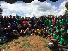 Delegates from European Union in Rwanda pose for a photo with project staff and  community members after a successful tree planting day spearheaded by the Commission