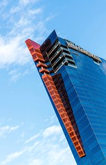 Red Arrow (Karen_Chappell) Tags: red blue building travel usa city urban lasvegas architecture abstract sky lines glass hotel nevada canonef24105mmf4lisusm skyscraper steel clouds tilt angle colour color geometry geometric