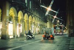 Bologna (goodfella2459) Tags: nikonf4 afnikkor50mmf14dlens cinestill800t 35mm c41 film analog colour city streets filter crossstarfilter bologna italy road lensfiltersgroup night light manilovefilm
