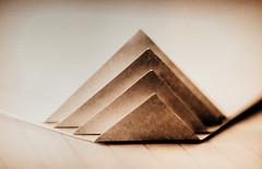 Triangle (Inka56) Tags: macromondays triangle paper monochrome monochromebokeh supertakumar255 manualfocus extendedtube21mm shallowdepthoffield crazytuesday guesswhatthisis hmbt sepia