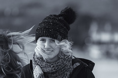 Windswept (Frank Fullard) Tags: frankfullard fullard candid street portrait lady beauty blonde black white blanc noir wind weather pom scarf monochrome achill doega dooega newyear smile fun fundraising mayo irish ireland