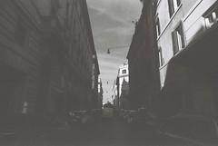 Roma (goodfella2459) Tags: nikonf4 afnikkor24mmf28dlens fomapanprofilineclassic100 35mm blackandwhite film analog city streets road buildings cars italy roma rome bwfp