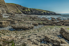 "Photo of ""Pillow Mounds"" headland from Dunraven Bay, South Wales."