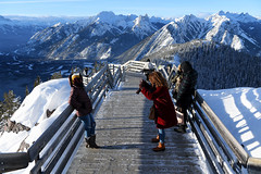 Stopping For a Photo (Anthony Mark Images) Tags: sansonpeak people portrait cellphonephotogrpher boardwalk mountainrange canadianrockies canada banff banffnationalpark alberta sunshine snow snowcoveredtrees railings beautifulview gorgeous nikon d850 flickrclickx redhair
