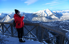 A Photo from the top of Sanson Peak. (Anthony Mark Images) Tags: redcoat blackhat sungasses woman cellphonephotographer railings topofsansonpeak ladytakingaphoto people portrait mountainrange cascademountain townofbanff snow platform lookoutpoint snowcoveredtrees beautifulview banff banffnationalpark alberta canada canadianrockies nikon d850 flickrclickx