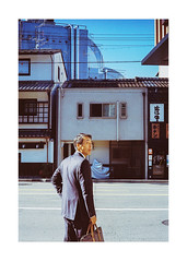 Salaryman (James Eleftherion) Tags: leica kodak homedeveloped c41 expired tetenal fujifilm frontier sp500 filmshooter filmcamera buyfilmnotmegapixels 35mmfilm analog geometry lines portrait portra observations beliveinfilm filmisnotdead lensculture homes film vividcolor iso400 sunny afternoon m3 japan lomo reflections tokyo 50mm 35mmlens 35mm fish blue lights kyoto sundown goldenhour crosswalk white red yellow brown suit briefcase grey oldtown