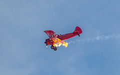 Caught The Flame From Stunt Pilot Vicky Benzing Intentional Engine Stall and Restart. (RS2Photography) Tags: rs2 ross vicky monoplane stunt flame canon flickr awesome rossome nellis cau aerobatics aerial flying usa america flight boeing benzing aviation vickybenzing boeingstearman smugmug drvickybenzing nellisafb californaaeronauticaluniversity calaero rs2photography photography aerialacrobatics 1940boeingstearman lasvegas lasvegasairshow stuntplane stuntpilot pilot femalepilot girlpower sky art stearman n63529 stearmann63529 250mm nevada