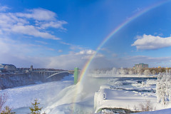 Rainbow in front of Rainbow Bridge (Notkalvin) Tags: rainbow rainbowbridge niagarafalls niagara waterfall falls water niagarariver newyork canada internationalborder outdoors frozen winter cold ice iced icy snow beautifulday nature frigid