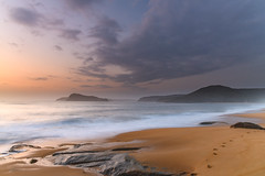 Sunrise at the beach with clouds and footsteps (Merrillie) Tags: daybreak landscape nature water sea waves sky northpearlbeach rocky newsouthwales rocks earlymorning morning pearlbeach coast ocean dawn sunrise nsw coastal australia outdoors waterscape seascape centralcoast clouds seaside