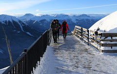 Walking to the Summit (Anthony Mark Images) Tags: people platform boardwalk banff banffnationalpark alberta canada canadianrockies sansonpeak snow sulphurmountain summit redcoat blackscarf sunshadows mountaintop mountains beautifulview nikon d850 flickrclickx