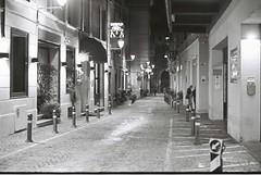 Bologna (goodfella2459) Tags: nikonf4 afnikkor50mmf14dlens kodaktmax400 35mm blackandwhite film night city bologna italy street road buildings light bwfp
