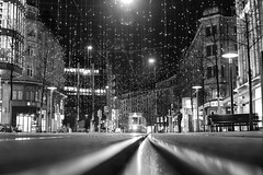 The sky is not falling (PeterThoeny) Tags: zurich switzerland bahnhofstrasse city christmaslight christmasdecoration light decoration lucie night outdoor tram train monochrome blackandwhite sony 1xp raw photomatix hdr qualityhdr qualityhdrphotography sonya7 a7 a7ii a7mii alpha7mii ilce7m2 fullframe vintagelens dreamlens canon50mmf095 canon fav200