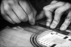 Avec une grande précision... / With great precision... (vedebe) Tags: mains hands humain human people travail work art artiste artisan musique guitare noiretblanc netb nb bw monochrome