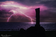 Bring Down The Monument! (Alfred Grupstra) Tags: nature sunset sea sky cloudsky landscape dusk water outdoors night dramaticsky dark cloudscape silhouette scenics lightning 879 monument statue