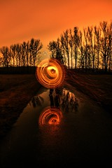 Artificial fiery whirl 🔥 (tadeas_h) Tags: artificiallfierywhirl fierywhirl whirl photomatix winter december 2019 sony sonya7 fullframe mirrorless longexposure fire burning pyrotechnicfuse light lightpainting trees focus depthoffield dof orangesky night nightphoto nightadventure colours tripod reflection water