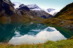 Alpine Harmony (mark.paradox) Tags: austria kaprun mooserboden uppertauernnationalpark lake view landscape mountains travel reflection autumn picturesque beautiful amazing water mirror adventure trip clouds scenery relax tranquil elevation colors sky alpine alps europe harmony silence coast