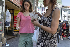 Two local women buying snack on the street (Braca Stefanovic) Tags: authentic break cash caucasian casual center cloth city day downtown dress europe fastfood female hand leisure life local metropolis money people person portrait real scene shopping snack sidewalk spontaneous streetphotography urban women bracastefanovic belgrade serbia