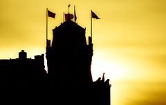 Low Sun, High Profile (Hans Veuger) Tags: nederland thenetherlands amsterdam amsterdamcentrum prinshendrikkade oosterdokseiland ode oosterdokskade hotel sunset zonsondergang flags silhouette backlight tegenlicht nikon b700 coolpix nederlandvandaag unlimitedphotos twop pbwa