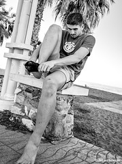 Get your socks on (Bart van Hofwegen) Tags: seaside boulevard sock socks man dressing street streetphotography city citystreet citylife citypeople urban urbanphotography urbanlife blackandwhite monochrome málaga malaga