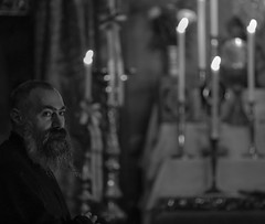 How it feels to be a monk? (ybiberman) Tags: israel jerusalem oldcity alquds armenianquarter saintjamescathedral monk streetphotography documentary people candles beard thearmenianpatriarchateofjerusalem bw darkness