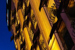 Night Balconies (Karen_Chappell) Tags: travel lasvegas usa nevada architecture orange blue balconies hotel building canonef24105mmf4lisusm tilt night angle black geometry geometric abstract city urban