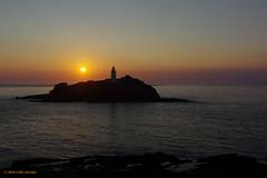 3KB16335a_C (Kernowfile) Tags: cornwall cornish pentax godrevylighthouse godrevyisland sunset sunsetmoment water reflections rocks island slope sky sunsetsky cliffs horizon sunlight waves lighthouse