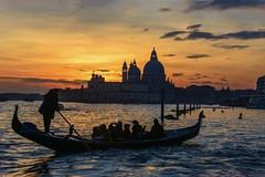 Venetian sunset (gianmaria.colognese) Tags: sunset tramonto venezia rosso orange yellow giallo red lagoon laguna waves gondola turisti chiesa smaria della salute
