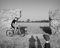 Burgh Castle (p2-r2) Tags: nikon f3 f3hp blackandwhite film agfa apx 100 new emulsion sun england uk burgh castle sunset stone walls roman fort bicycle bike nikkor28mmf28ais norfolk