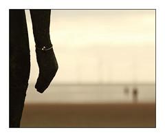 The Bracelet (david.hayes77) Tags: shoreline seaside spring anotherplace castiron figure coast merseyside beach sand sea 2012 guard blundellsands sefton installation art bracelet dof silhouette jewelry