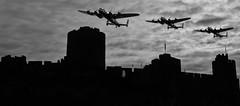 Pembroke Flight (MedievalRocker) Tags: wolfmoon lancasterbombers pembrokecastle clouds flags silhouette