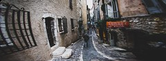 An old man walking in an alley ... II (sKamerameha) Tags: alley walk oldman street people cobble travel france human