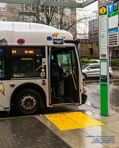 A Passenger Boarding the TransLink Rapidbus R4 at Joyce-Collingwood Station Bay 3 in Full Living Colour