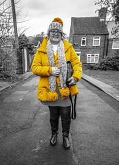 Mellow Yellow. . . (CWhatPhotos) Tags: cwhatphotos flickr artistic art photographs photograph pics pictures pic picture image images foto fotos photography that have which with contain olympus omd em1 mk ll micro four thirds 43 camera portrait woman female street walk path road yellow coat pom hat warm cosy back color colour colours colors select selective partial smile smiles smiler