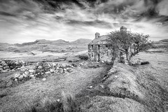 Llwyn y Betws (Ffotograffiaeth Dylan Arnold Photography) Tags: llwynybetws wales cymru monochrome blackandwhite landscape house building dwelling home rural countryside mountains fields meadows grass tree hawthorn ruin decay crumbling wall drystonewall rocks stones sky clouds contrast hills cwm windows doorway old forgotten abandoned derelict ruined remote lonely isolated isolation peaceful idyllic tranquil bucolic nature reclaiming pasture roof slates stories outdoor getaway alone mysterious copyspace walls buttress skyline