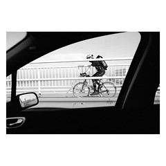 . (halagabor) Tags: bnw blackandwhite monochrome car window bike biker bicycle budapest bridge traffic driver hungary hungarian analog analogcamera film filmisnotdead filmcamera filmisalive filmphotography ishootfilm ilfordfilm istillshootfilm street streetphoto streetphotography pushed 1600 ilford ilfordhp5 hp5 grain grainy nikon nikkor nikonfe2