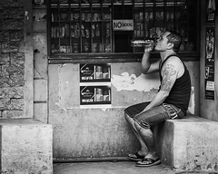 Thirst Quenching (Beegee49) Tags: street people man city sitting drinking store thirsty blackandwhite monochrome sony a6000 bw bacolod philippines asia happyplanet asiafavorites