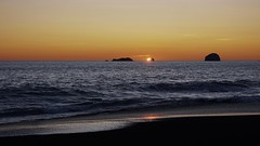Another good ending (Mary Ann Whitney-Hall) Tags: sunset reflection rocks seastacks oregon coast ocean beach waves water sky orange yellow