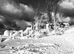 """""""Iced In"""" (reader630) Tags: weather ptbetsielighthouse scenicmichigan winter lighthouses thegreatlakes lakemichigan landscapes ngysabww blackandwhitephotography"""