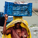 Longshoreman Carrying Frozen Fish, Sadarghat Dhaka Bangladesh
